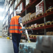 warehouse worker pulling forklift-ts-685855708.jpg
