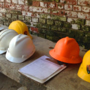 construction-hardhats-brick-bkgd.jpg