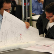 Architects look at blueprints at the World Trade Center