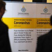 corona virus sign in airport