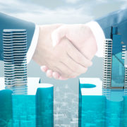 merger-handshake-officebuildings.jpg