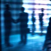 businessmen in shadow
