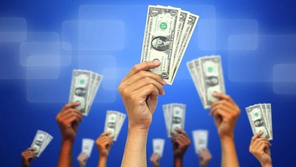 dollars-raised-hands