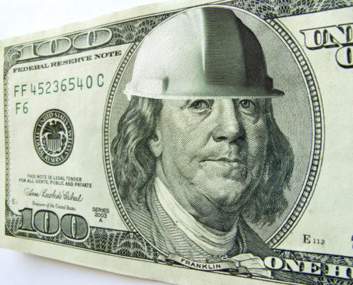construction money hundred hard hatGettyImages-157640619.jpg