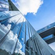 office bldg glass clouds reflected-ts-621261046.jpg