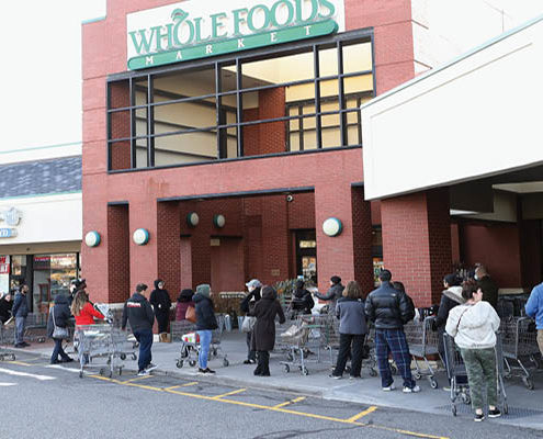 whole foods store-people waiting to get in