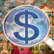 dollar sign magnifying glass apartment buildings